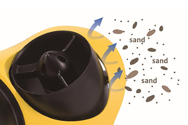 Close up of a motor rejecting sand getting stuck in it